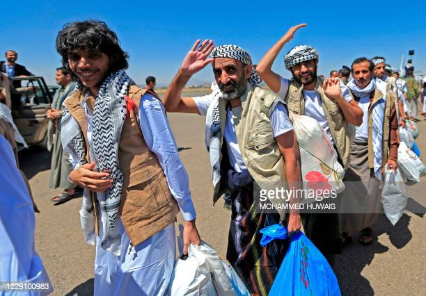 Freed Yemeni prisoners arrive in the rebel-held capital Sanaa, on October 16 as the war-torn country began swapping 1,000 prisoners in a complex...