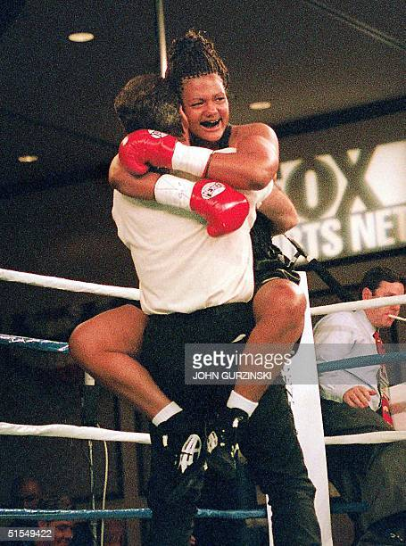 Freeda Foreman daughter of famed boxer George Foreman celebrates as she hugs her trainer Larry Goosen after winning her first professional fight at...