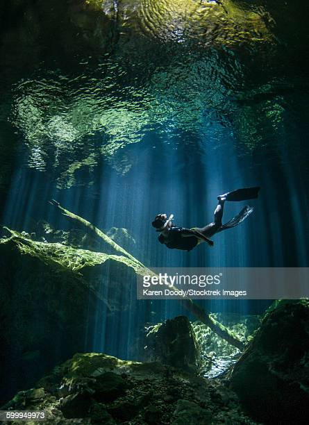 A freediver in Taj Mahal cenote in Mexico.
