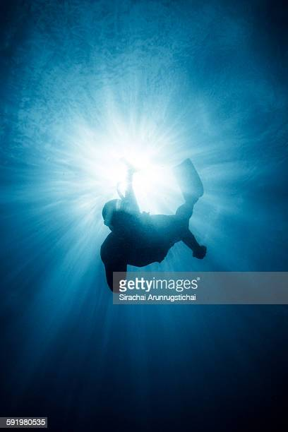 Freediver swims into the depth