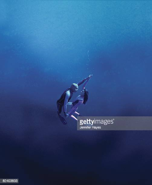 Portrait of husband and wife team Francisco Pipin Ferreras and Audrey Mestre taken underwater. Cover. 1/1/2000--7/1/2002 CREDIT: Jennifer Hayes