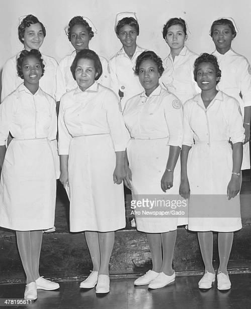 Freedmen's Hospital graduates 10 dietetic interns, with Houston A Baker, Assistant Superintendent, presiding, Washington DC, January 12, 1962....