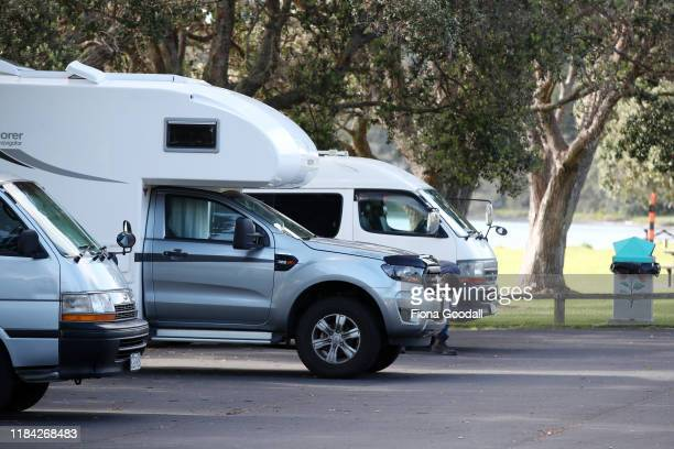 Freedom campers use the designated camping areas at Sunshine Reserve in Snell Beach on October 30 2019 in Auckland New Zealand Freedom camping is...