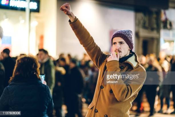 freedom fighter - protestor stock pictures, royalty-free photos & images