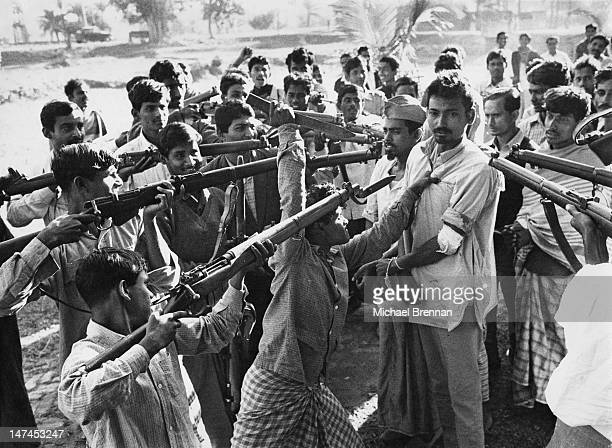 Freedom fighters with captured informer Razakhar, after the Indian Army liberated Jessore in Bangladesh, then part of East Pakistan, circa 1971.