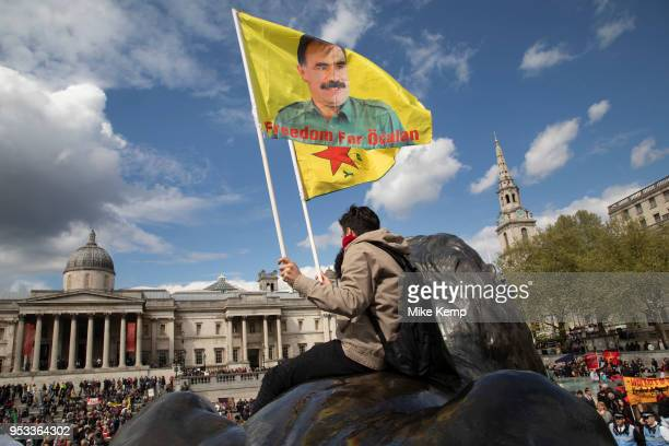 Freedom for Ocalan flags from the Trafalgar Square lions during May Day celebrations in London England United Kingdom Demonstration by unions and...