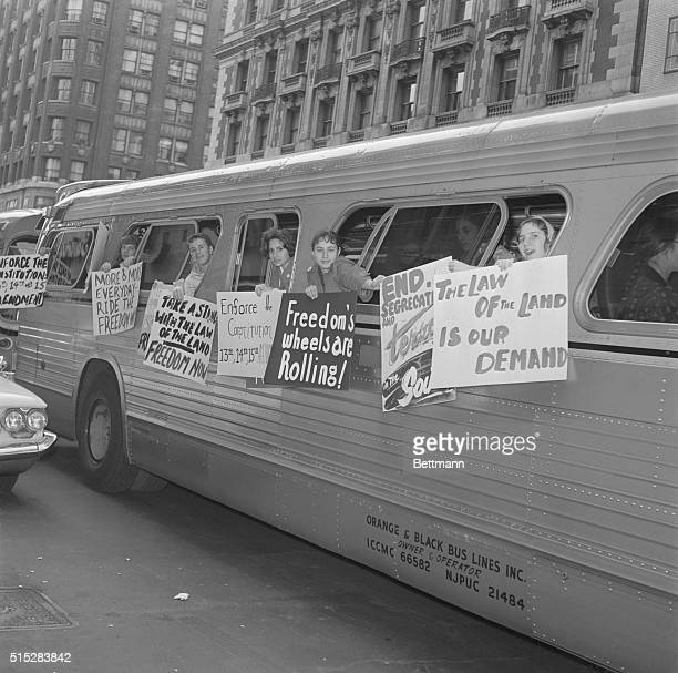 Freedom Group Hangs Signs on Bus New York Members of a group called 'The Washington Freedom Riders Committee' hang signs on the side of bus parked...