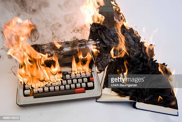 Freedom of expression journalism writers Representative photo on censorship and repression Our picture shows a burning typewriter a burning book and...