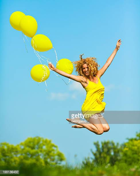 freedom - yellow dress stock pictures, royalty-free photos & images