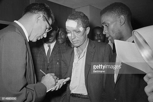Freedom Riders Jimmy McDonald and James Peck talk to reporter Bill Cook upon their arrival in New Orleans. Peck had been beaten by...