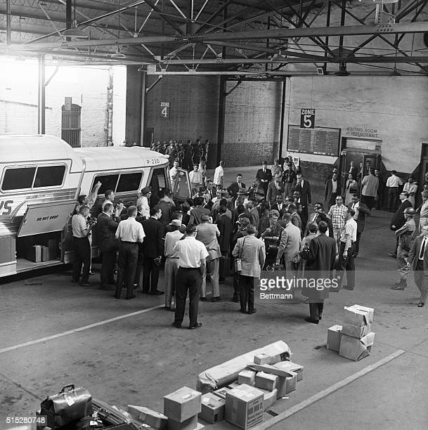 'Freedom Riders' surrounded by photographers prepare to board a Trailways bus for Mississippi from Montgomery Alabama under heavy guard by state...