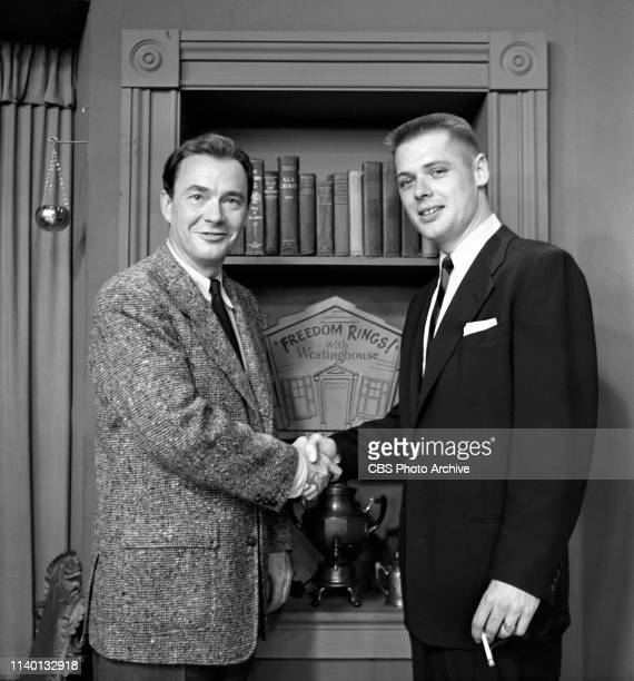 Freedom Rings, a CBS television audience participation game show, hosted by John Beal. Beal stands at left, with contestant. May 12, 1953.