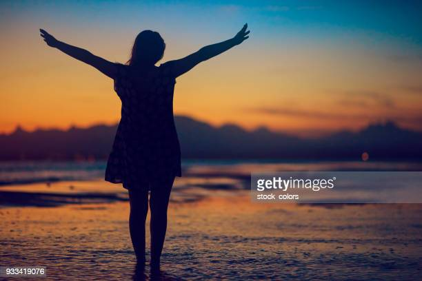 freedom silhouette on the beach - forever young stock pictures, royalty-free photos & images