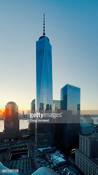freedom tower and 9/11 memorial plaza at sunset - freedom plaza stock pictures, royalty-free photos & images