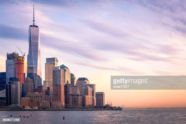 freedom tower and lower manhattan in the evening - hudson river stock pictures, royalty-free photos & images