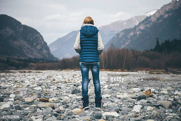 Freedom. Unrecognizable female person looking on mountains.