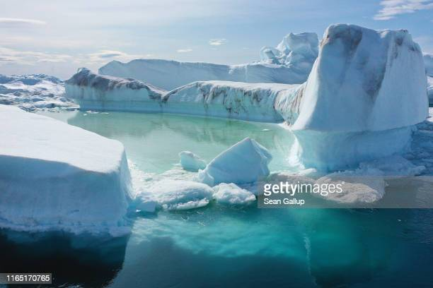 Free-floating ice floats jammed into the Ilulissat Icefjord during unseasonably warm weather on July 30, 2019 near Ilulissat, Greenland. The Sahara...