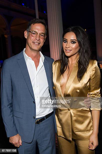 Freeform President Tom Ascheim and actress Shay Mitchell attend the 12th Annual Outfest Legacy Awards at Vibiana on October 23 2016 in Los Angeles...