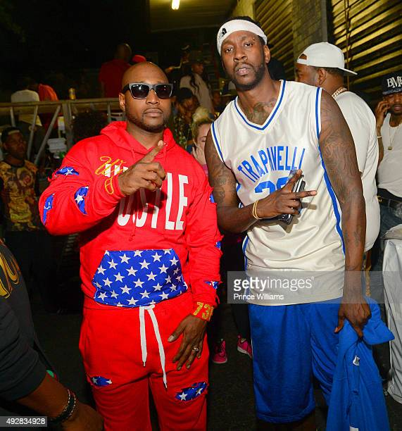 Freekey Zekey and 2 Chainz attend Battle of the Black Top BasketBall Game at Street Execs Studios on October 8, 2015 in Atlanta, Georgia.
