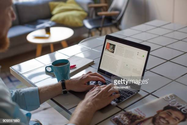 freelance businessman working on his laptop at home, partial view - blogging stock pictures, royalty-free photos & images