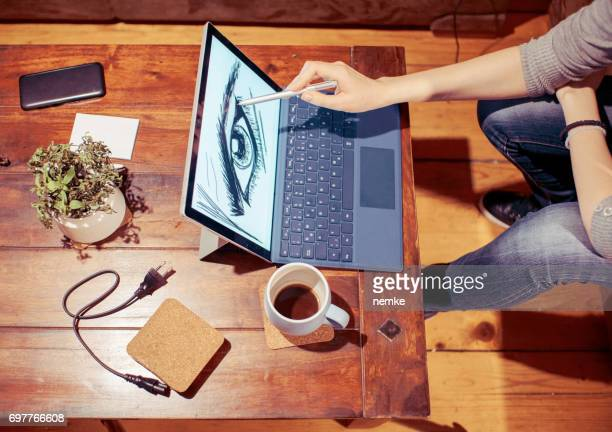 freelance graphic designer using graphic tablet - illustrator stock photos and pictures