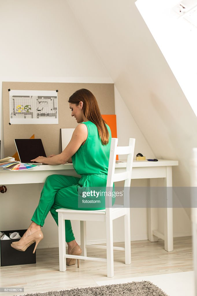 Freelance Interior Designer Working At Laptop : Stock Photo