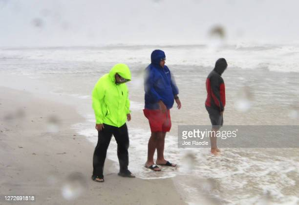 Freelance journalist, Trey Greenwood, Micah Hart and Alec Scholten are battered by the winds and rain from the outer bands of Hurricane Sally on...