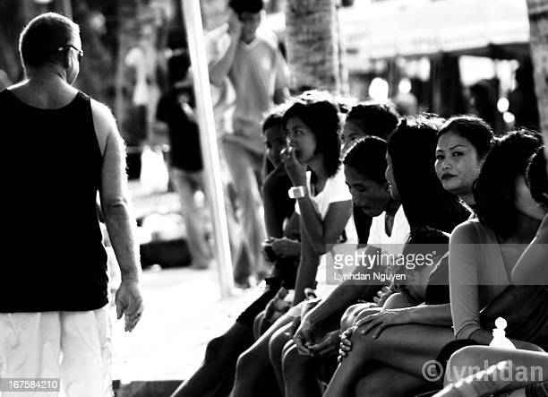 CONTENT] Freelance ladies sits and wait to be picked up by a foreigners on Beach Road Pattaya Thailand