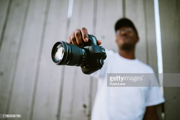 freelance photographer showing off camera - photographer stock pictures, royalty-free photos & images