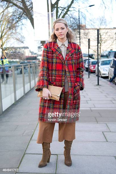 Freelance stylist Poppie Clinch wears all vintage except Zara Culottes on February 24 2015 in London England