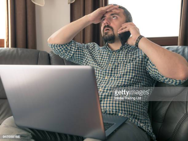 freelance worker in disbelief by his client - displeased stock pictures, royalty-free photos & images