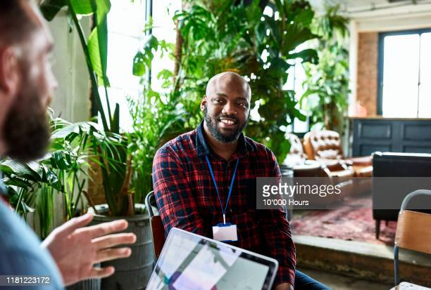 freelance worker listening to brief for product launch - publicity event stock pictures, royalty-free photos & images