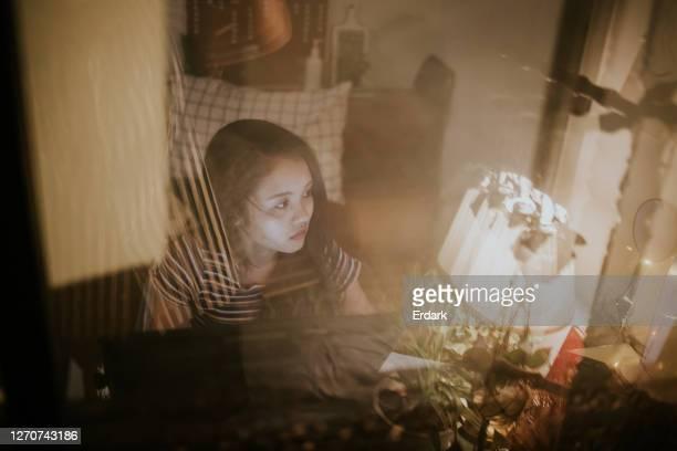 freelancer creative designer working late with nighttime story-stock photo - excesso de trabalho imagens e fotografias de stock