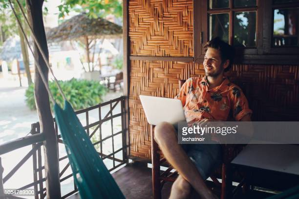 freelancer man doing work outdoors in thailand - surat thani province stock pictures, royalty-free photos & images