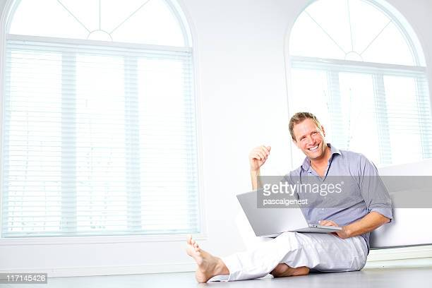 freelancer using a laptop looking at the camera