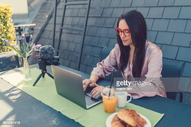 freelancer vlogging from rooftop terrace - influencer stock photos and pictures