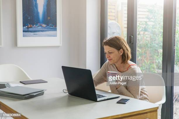 freelancer working from home - home office stock pictures, royalty-free photos & images