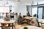 Freelancers working on computers in modern coworking space