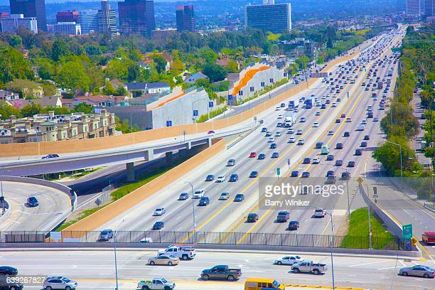 freely-moving traffic on major l.a. highway - highway 405 stock photos and pictures