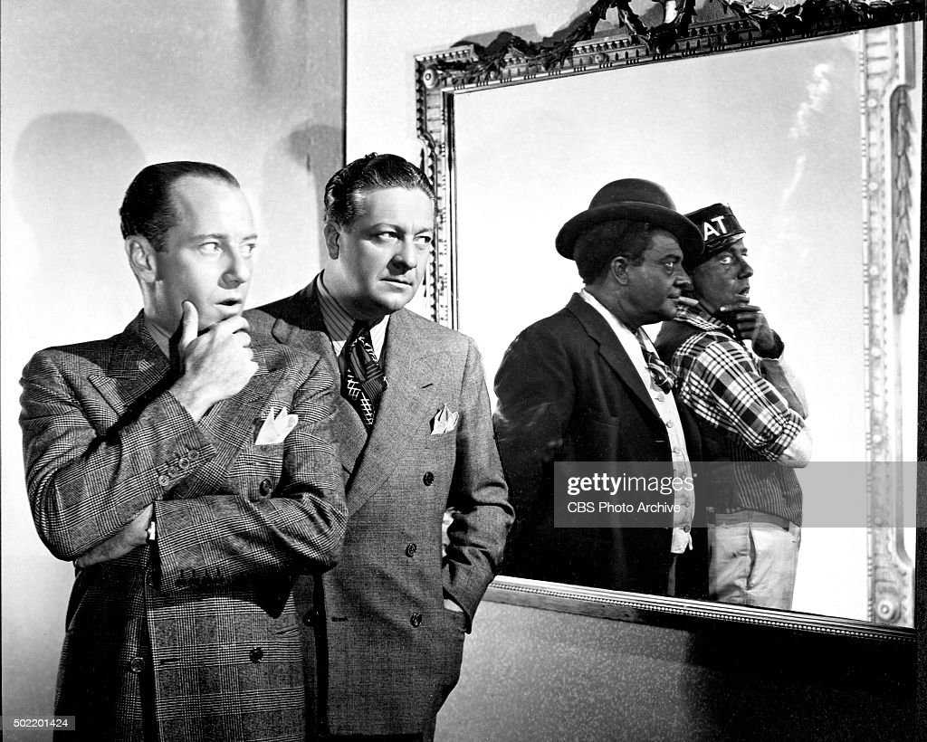 Freeman Gosden (far left) who plays the character Amos Jones (far right) and Charles Correll (second from left) who plays the character Andy Hogg Brown (second from right) on the CBS radio program, 'Amos 'n' Andy.' Image dated May 1, 1939. Hollywood, California.