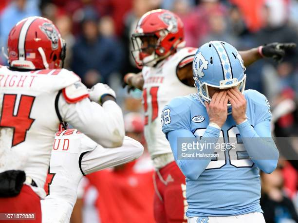 Freeman Jones of the North Carolina Tar Heels reacts after missig a field goal in overtime against the North Carolina State Wolfpack at Kenan Stadium...