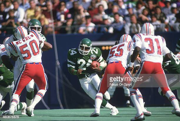 Freeman McNeil of the New York Jets carries the ball against the New England Patriots during an NFL football game September 11 1986 at The...