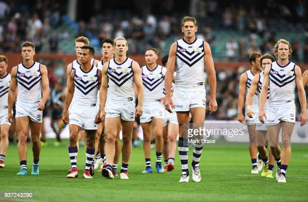 Freemantle leave the ground after being beaten during the round one AFL match between the Port Adelaide Power and the Fremantle Dockers at Adelaide...