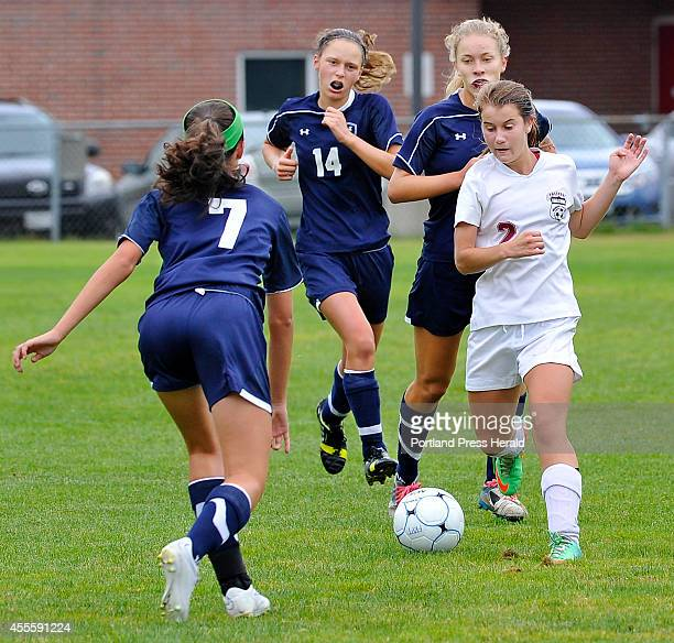 Freeport Alyssa Richardson controls the ball into the Yarmouth zone defended by Lauren Bartlett as Freeport hosts Yarmouth in girls high school...
