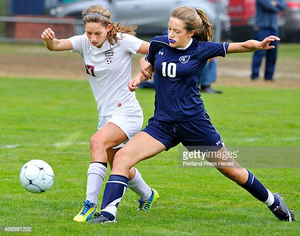 Freeport Elizabeth Martin battles for control with Yarmouth Ella Antolini as Freeport hosts Yarmouth in girls high school soccer action