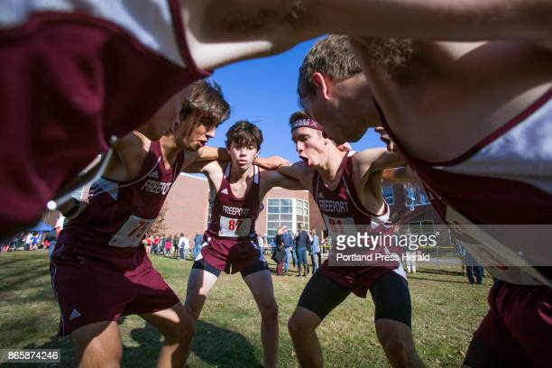Freeport juniors Tanner Morrison Dawson Pillow and Alex Les lead a team cheer before the start of the Western Maine Conference cross country...