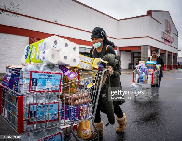 Freeport residents Cortia Morris and her daughter Lashae Haughton leaving BJ's Wholesale Club in Freeport,New York after getting water and paper...