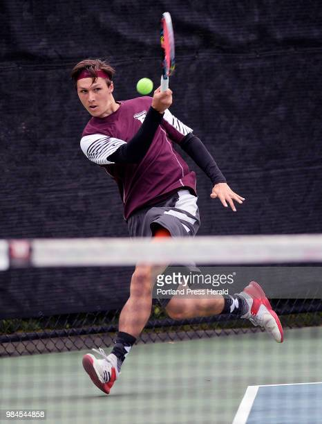 Freeport's Aaron Rusiecki chased down the ball during the Southern Maine regional tennis championships at Bates College in Lewiston Thursday June 7...