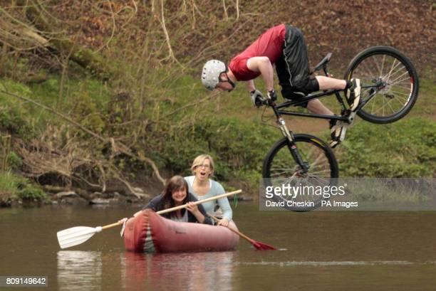 Freeride mountain biker Jack Hood launches himself into the river Tweed in Peebles Scottish Borders as part of the launch of the TweedLove Bike Week...