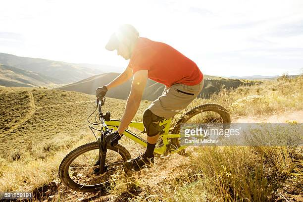 Freeride mountain biker riding at sunset.